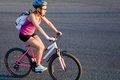 Cycling young sporty woman in helmet outdoor Royalty Free Stock Photography