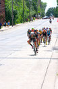 Cyclist chase group races downhill at stillwater women pro cyclists bottom of long in final stage of north star grand prix Stock Photo