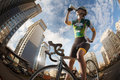 Cyclist in the city is drinking water from sport bottle Stock Image