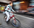 Cyclist on the city roadway abstract image of intentional motion blur Royalty Free Stock Photography