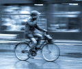 Cyclist on the city roadway in motion blur Stock Image