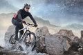 Cyclist climbing on a rock Stock Photo