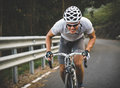 Cyclist in maximum effort a road outdoors Stock Images