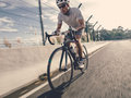 Cyclist in maximum effort a road outdoors Royalty Free Stock Photography
