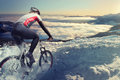 Cyclist in the mountains snow road Stock Photo