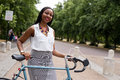 Cyclist in the park young woman with her bike Royalty Free Stock Image