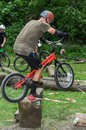 LVIV, UKRAINE - JUNE 2018: A cyclist performs tricks on a bicycle trial to overcome an obstacle course Royalty Free Stock Photo