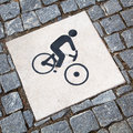 Cyclist pictogram of a on a bikeway from cobblestones Royalty Free Stock Photography