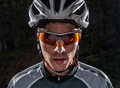 Cyclist portrait with flash light in a forest outdoors Stock Photography