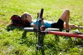 Cyclist relaxation lying in the fresh grass Stock Images