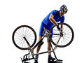 Cyclist repairing bicycle silhouette in on white background Stock Images