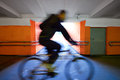 Cyclist rides through the underpass Stock Images