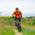 Cyclist riding the bike on the beautiful mountain trail spring Stock Photo