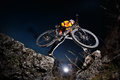 Cyclist Riding the Bike Down Hill on the Mountain Rocky Trail at Sunset. Extreme Sports Royalty Free Stock Photo