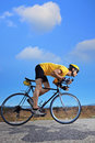 Cyclist riding a bike on an open road Stock Images
