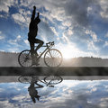 Cyclist riding a road bike at sunset Royalty Free Stock Photo