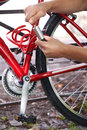Cyclist Securing Bike With Lock Royalty Free Stock Photo