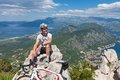 Cyclist on the top of a hill sitting background bay and sea Stock Images