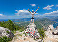 Cyclist on the top of a hill with their hands up Royalty Free Stock Image