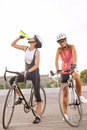 Cyclist woman takes a water break portrait of women outside Stock Image