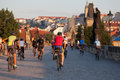 Cyclists on charles bridge jule prague czech republic annually prague is visited by more than million tourists Stock Photos