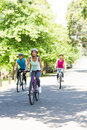 Cyclists cycling on country road male and female Stock Image