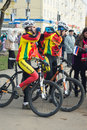 Cyclists in duffle with the inscription tver region russia oct on olympic torch relay on october Royalty Free Stock Photo