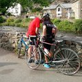 Cyclists in lycra man woman afon river glaslyn beddgelert snowdonia national park noryh wales uk Stock Photography