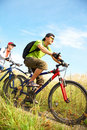 Cyclists on meadow Stock Image