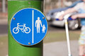 Cyclists and pedestrians a sign highlighting a path that is shared by Royalty Free Stock Photography