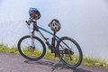 Cyclo cross bicycle with a helmet, standing at the road near reservoir. Royalty Free Stock Photo
