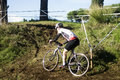 Cyclo cross competitor in action during an event at the acquedotti cinecitta park rome italy Royalty Free Stock Photography