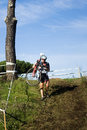Cyclo cross competitor in a race carrying his bike down hill during the event at the acquedotti cinecitta park rome italy Royalty Free Stock Images