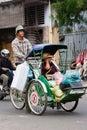 Cyclo driver and his passenger/customer Stock Photo
