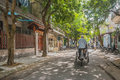 Cyclo on a quiet street in old Hue Vietnam Royalty Free Stock Photo