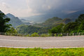Cyclone winding paved road in the italian alps Stock Photos