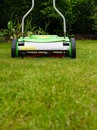 Cylinder lawn mower on grass Royalty Free Stock Photo