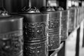 Cylindrical metal prayer wheels in kyoto detail of a row of japan with the mantra written on the outside of the shallow dof Stock Photos