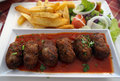 Cypriot food keftedes meatballs in sauce Royalty Free Stock Photos