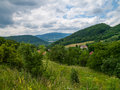 Czech landscape with abandoned field and mountains near horizon Stock Photography