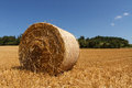 Czech landscape with straw bale hay roll Royalty Free Stock Photos