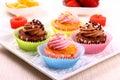 Cztery apetycznej babeczki na bielu talerzu Obrazy Royalty Free