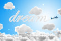 D airplane writing the word dream in the sky travel concepts Stock Photo