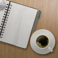 3d cup of coffee in a white cup and blank note book Royalty Free Stock Photo
