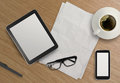 D empty tablet with mobile phone and a cup of coffee on the wooden desk Royalty Free Stock Photo