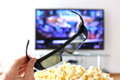 D glasses against tv set Stock Image