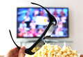 D glasses against tv set Stock Photo