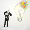 D human character is body suit looking at abstract colorful lig morphsuit lightbulb Royalty Free Stock Photo