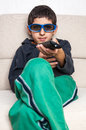 D polarized glasses boy kid with remote control looking at movie using Stock Photos