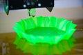 3d printer printing abstract green shape